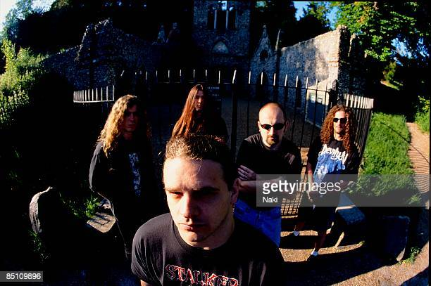 Photo of CANNIBAL CORPSE Posed group portrait in cemetery LR Paul Mazurkiewicz Pat O'Brien George 'Corpsegrinder' Fisher Jack Owen and Alex Webster