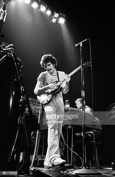 Photo of Carlos SANTANA and SANTANA Carlos Santana performing live onstage with Santana playing Gibson SG guitar using wahwah pedal