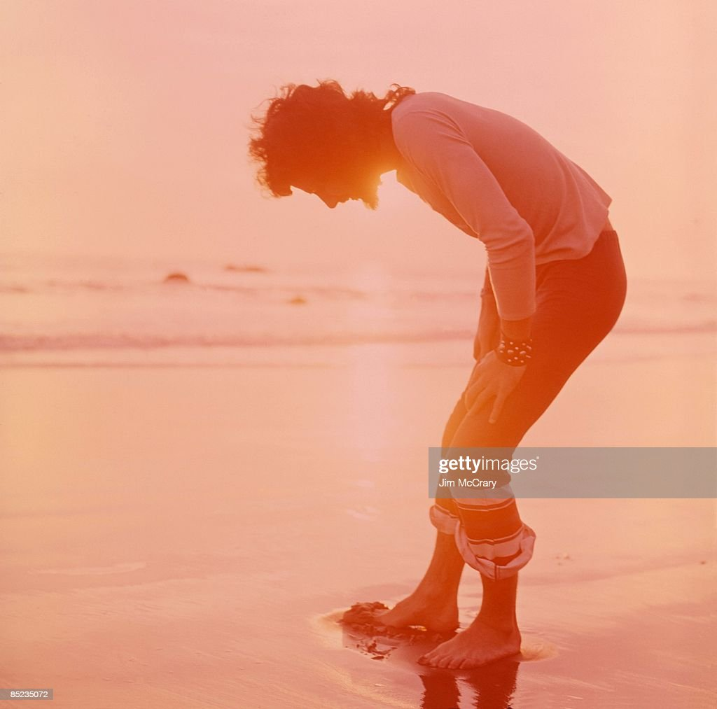 Photo of Cat STEVENS; on Malibu Beach, just before the near drowning that went on to spark his religious conversion