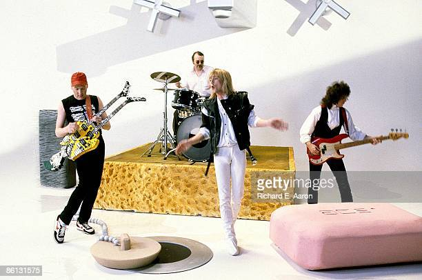 Photo of CHEAP TRICK and Rick NIELSEN and Bun E CARLOS and Robin ZANDER and Jon BRANT Group performing dyring a video shoot LR Rick Nielsen Bun E...