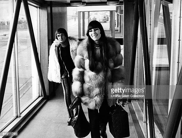 Photo of CHER and Sonny BONO and SONNY CHER Carrying bags L R Sonny Bono Cher