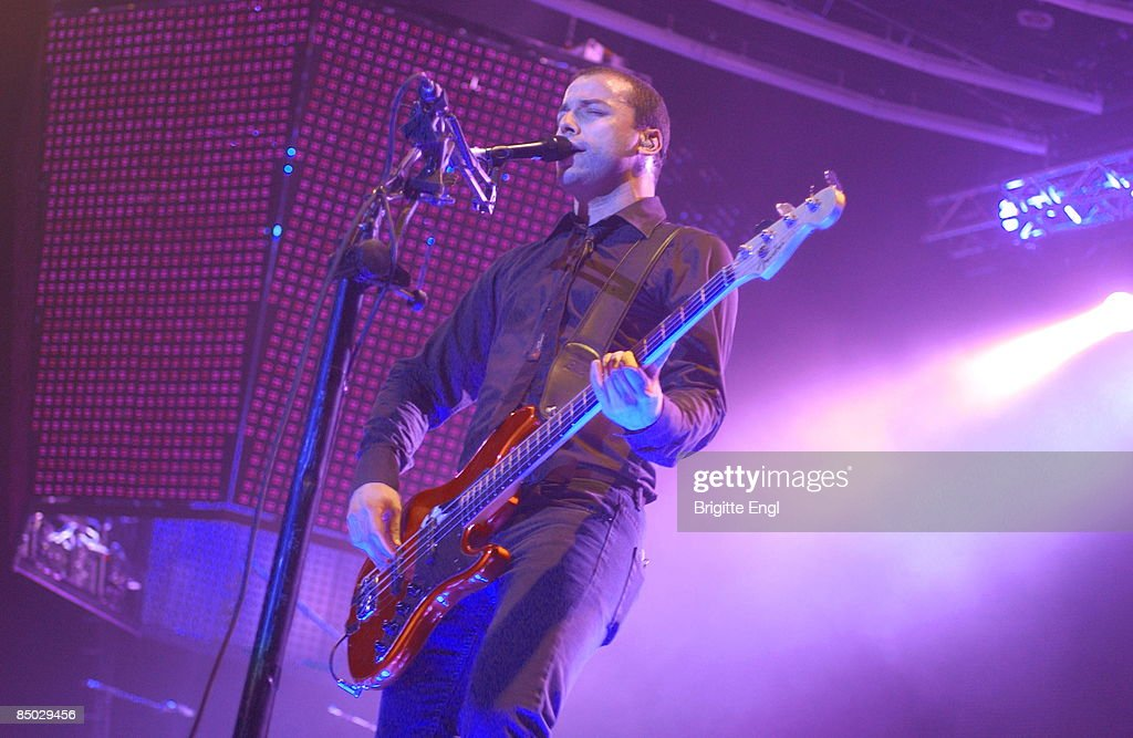 ARENA Photo of Chris WOLSTENHOLME and MUSE Chris Wolstenholme playing Bass live on stage