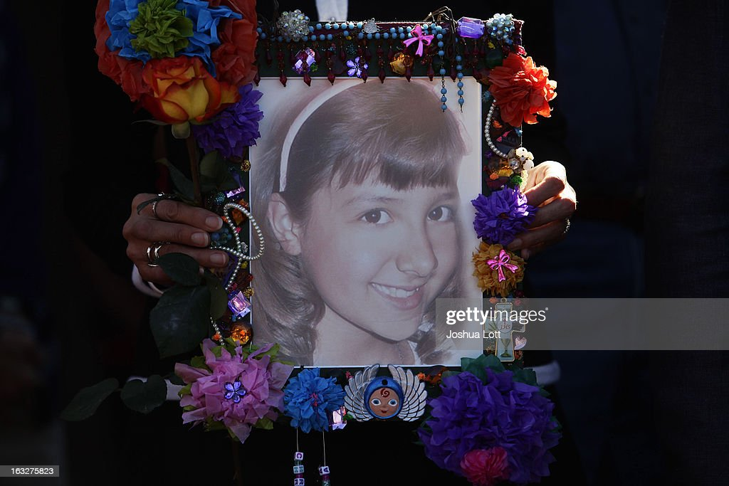 A photo of Christina Taylor Green, who was killed in the January 8, 2011 Tucson shooting, is held during a news conference outside Safeway grocery store where former U.S. Rep. Gabby Giffords and her husband Mark Kelly asked Congress to provide stricter gun control in the United States on March 6, 2013 in Tucson, Arizona. Giffords and Kelly were joined by survivors of the Tucson shooting that took place there two years ago when six people were killed and Giffords herself was shot in the head.