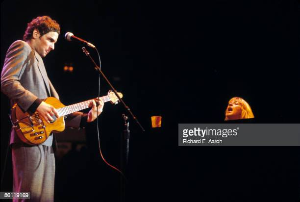 Photo of Christine McVIE and Lindsey BUCKINGHAM and FLEETWOOD MAC LR Lindsey Buckingham Christine McVie performing live onstage
