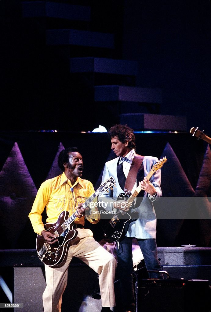 Photo of Chuck BERRY and Keith RICHARDS; Chuck Berry and <a gi-track='captionPersonalityLinkClicked' href=/galleries/search?phrase=Keith+Richards+-+Musician&family=editorial&specificpeople=202882 ng-click='$event.stopPropagation()'>Keith Richards</a> performing on stage at Chuck's 60th Birthday Concert for the filming of 'Hail Hail Rock & Roll'