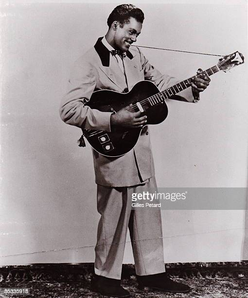 Photo of Chuck BERRY Posed studio full length portrait of Chuck Berry with guitar