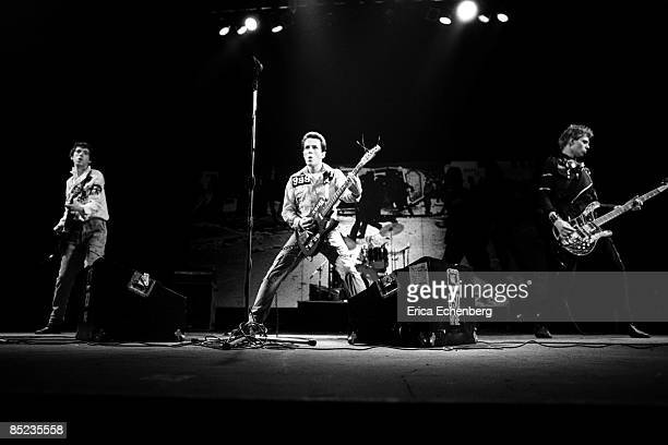 THEATRE Photo of CLASH and Paul SIMONON and Joe STRUMMER and Mick JONES LR Mick Jones Joe Strummer Paul Simonon performing live onstage White Riot...