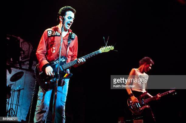 THEATRE Photo of CLASH Joe Strummer and Paul Simonon performing live onstage on White Riot Tour
