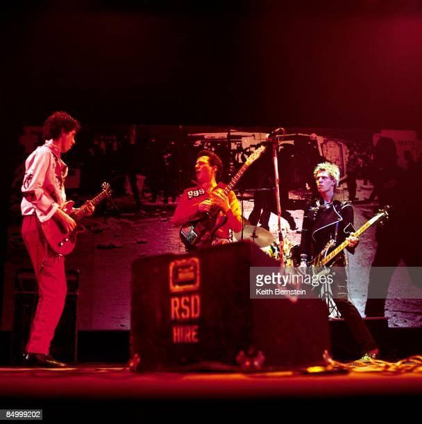 Mick Jones Joe Strummer Paul Simonon performing live onstage on White Riot Tour