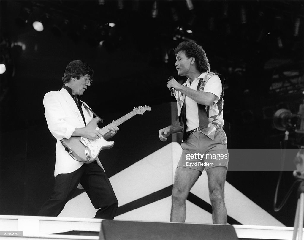 STADIUM Photo of Cliff RICHARD and Hank MARVIN and SHADOWS, Hank Marvin and <a gi-track='captionPersonalityLinkClicked' href=/galleries/search?phrase=Cliff+Richard&family=editorial&specificpeople=158267 ng-click='$event.stopPropagation()'>Cliff Richard</a> performing on stage, shorts