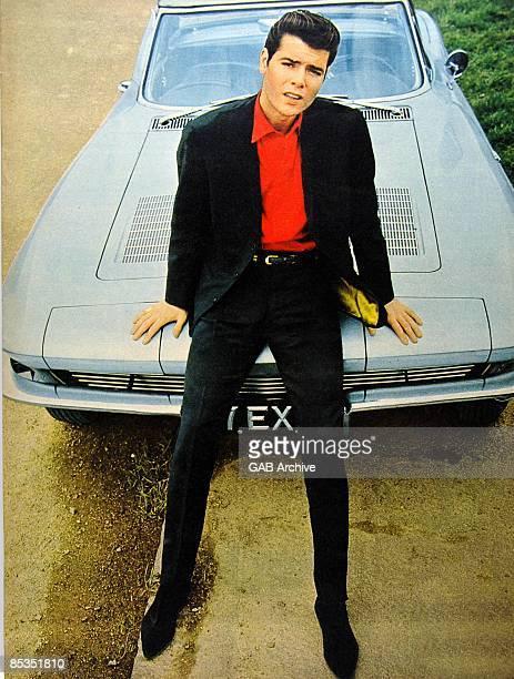 Photo of Cliff RICHARD Portrait sitting on a car c1962/1963
