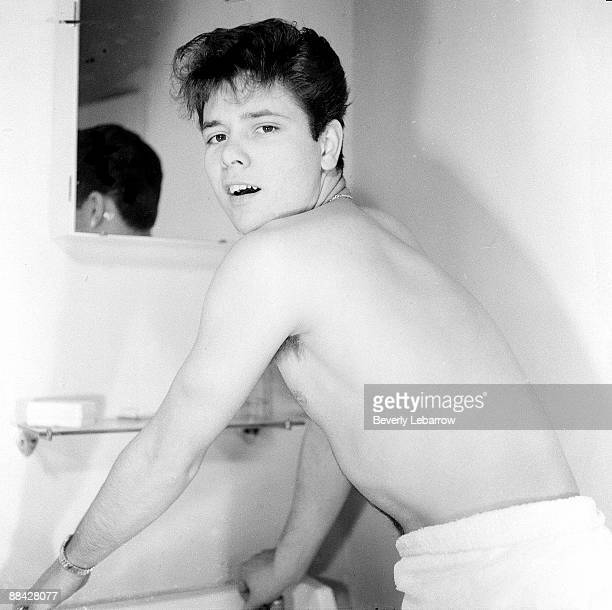 Photo of Cliff RICHARD posed in bathroom washing wearing towel c1958/1959