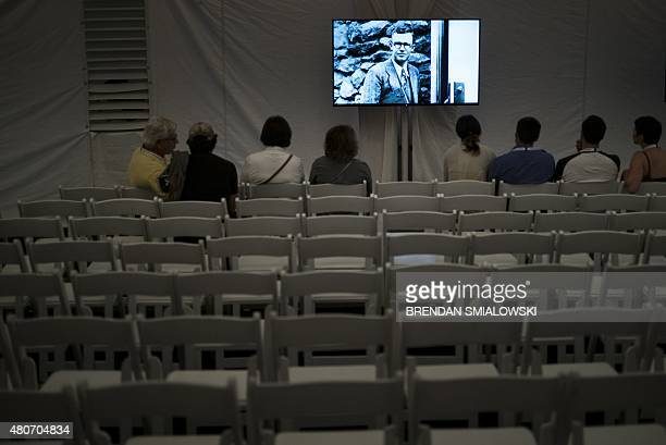 A photo of Clyde Tombaugh the discoverer of Pluto is shown as people wait for telemetry from the New Horizons probe at the Johns Hopkins University...