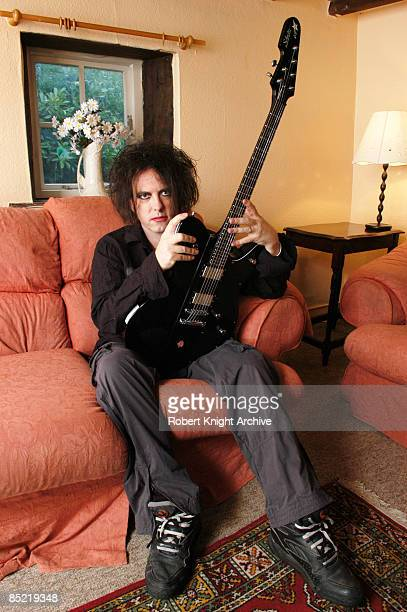 Photo of CURE and Robert SMITH Robert Smith of The Cure posed