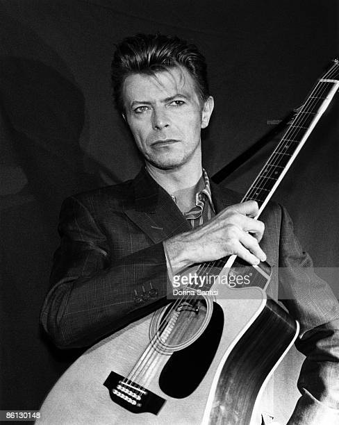 Photo of David BOWIE David Bowie performing on stage with acoustic guitar SoundVision tour