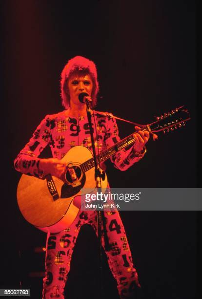 Photo of David BOWIE performing live onstage on first date of Ziggy Stardust US Tour at the Music Hall Cleveland playing 12 string acoustic guitar