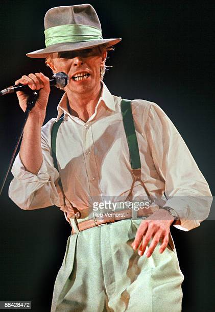 ROTTERDAM Photo of David BOWIE performing live onstage on Serious Moonlight tour wearing hat wearing braces