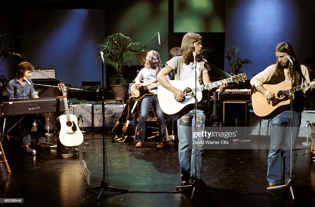 STUDIO Photo of David DICKEY and Dewey BUNNELL and Gerry BECKLEY and AMERICA and Dan PEEK, L-R: Dan Peek, David Dickey, Gerry Beckley, Dewey Bunnell - performing on TV show