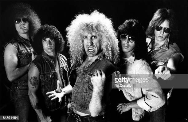 Photo of Dee SNIDER and TWISTED SISTER L R Mark Mendoza AJ Pero Dee Snider Eddie Ojeda and JJ French Posed studio group portrait