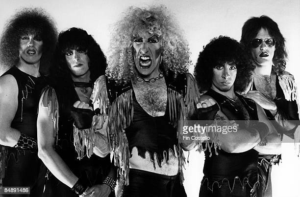 Photo of Dee SNIDER and TWISTED SISTER L R Mark Mendoza Eddie Ojeda Dee Snider AJ Pero and JJ French Posed studio group portrait