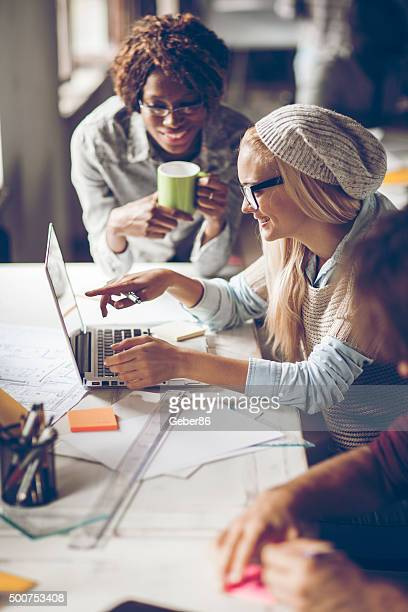 Photo of designers in good mood working together