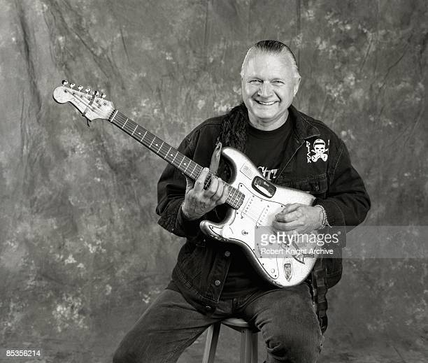 HOLLYWOOD Photo of Dick DALE Posed studio portrait of Dick Dale with a Fender Stratocaster guitar