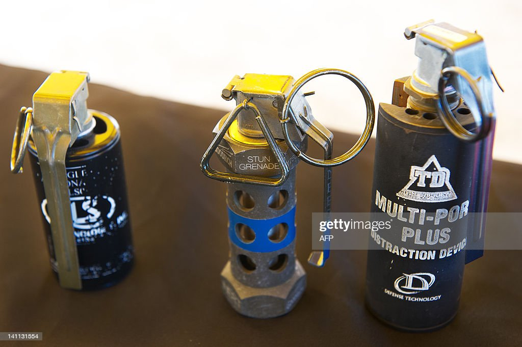 A photo of dispayed nonlethal flashbang / stun grenades on display during a media event showing nonlethal weapons at the US Marines Corps Base...