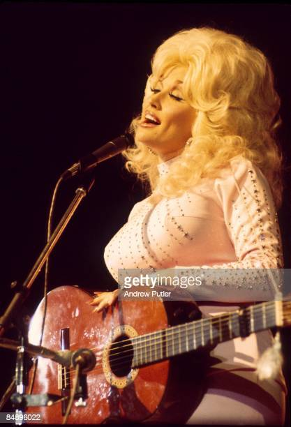 POOL Photo of Dolly PARTON Dolly Parton performing on stage acoustic guitar
