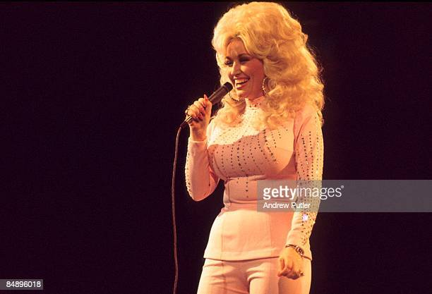POOL Photo of Dolly PARTON Dolly Parton performing on stage