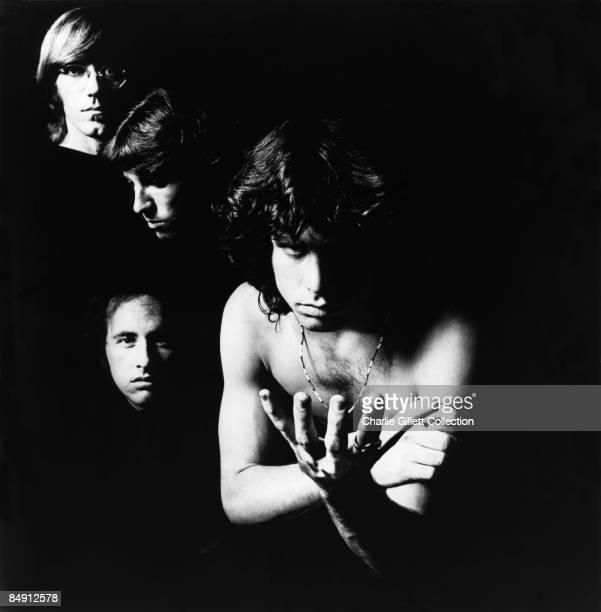Photo of DOORS studio posed LR Ray Manzarek Robbie Kreiger John Densmore Jim Morrison