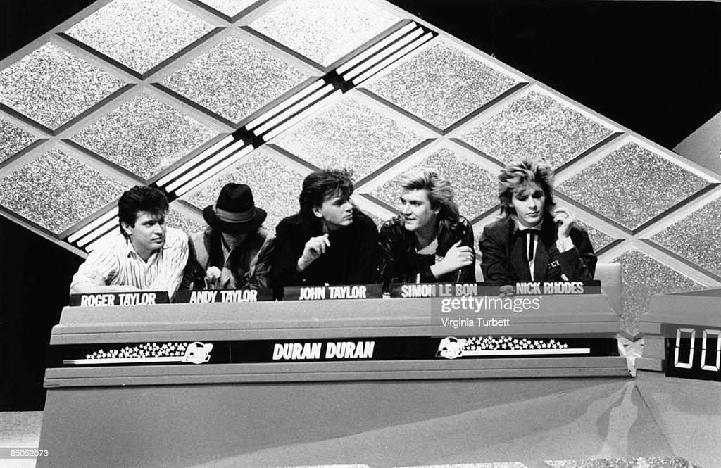 Roger Taylor, Andy Taylor, John Taylor, Simon Le Bon, Nick Rhodes - recording the Christmas Special of BBC 'Pop Quiz' TV show, with Spandau Ballet