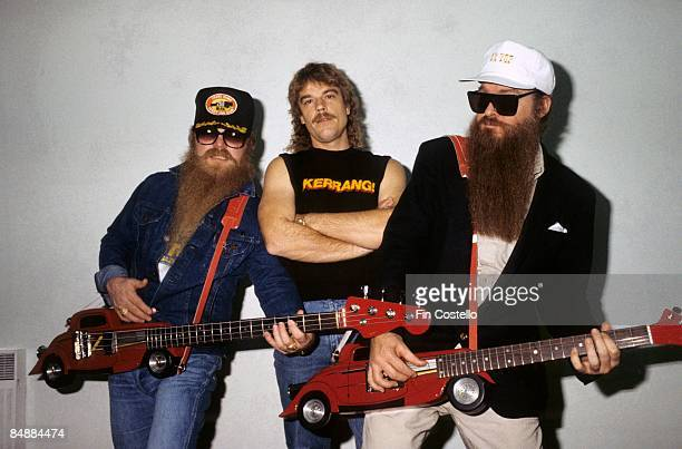 PARK Photo of Dusty HILL and Billy GIBBONS and Frank BEARD and ZZ TOP LR Dusty Hill Frank Beard and Billy Gibbons posed group shot backstage at...