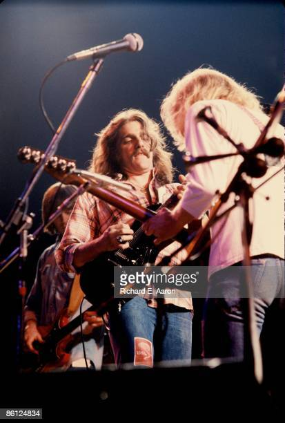 Photo of EAGLES and Randy MEISNER and Glenn FREY and Don FELDER LR Randy Meisner Glenn Frey and Don Felder performing on stage