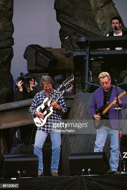 Photo of EAGLES Don Felder and Joe Walsh performing live onstage on Hell Freezes Over tour