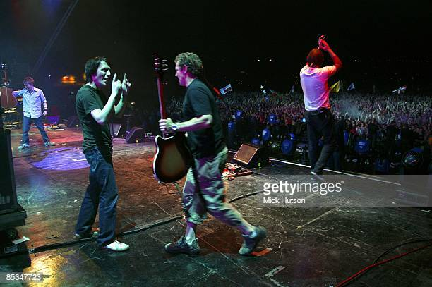 FESTIVAL Photo of Ed O'BRIEN and Thom YORKE and RADIOHEAD and Colin GREENWOOD LR Thom Yorke Colin Greenwood guitar tech Peter Clemens Ed O'Brien...