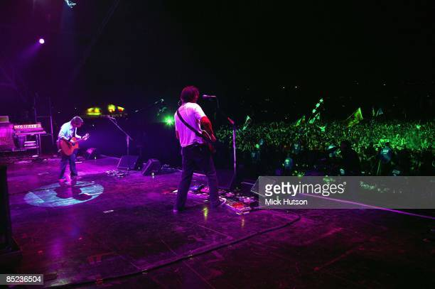 FESTIVAL Photo of Ed O'BRIEN and Thom YORKE and RADIOHEAD LR Thom Yorke Ed O'Brien performing live onstage view from stage looking out over audience