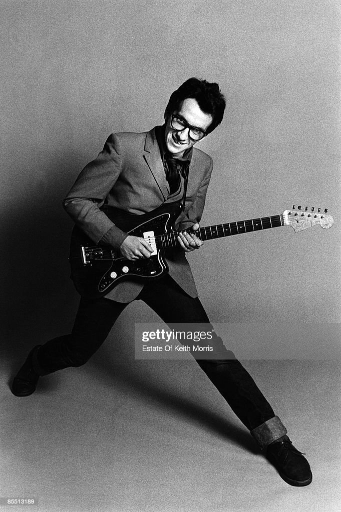 Photo of Elvis COSTELLO; studio, posed - 'My Aim is True' (1st Album) cover shoot