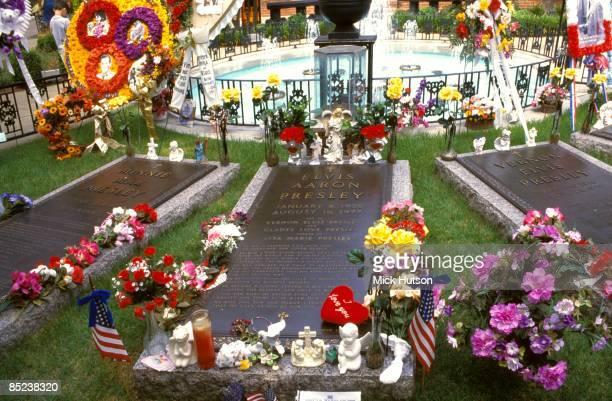 Photo of Elvis PRESLEY and GRACELAND Elvis Presley's grave at Graceland