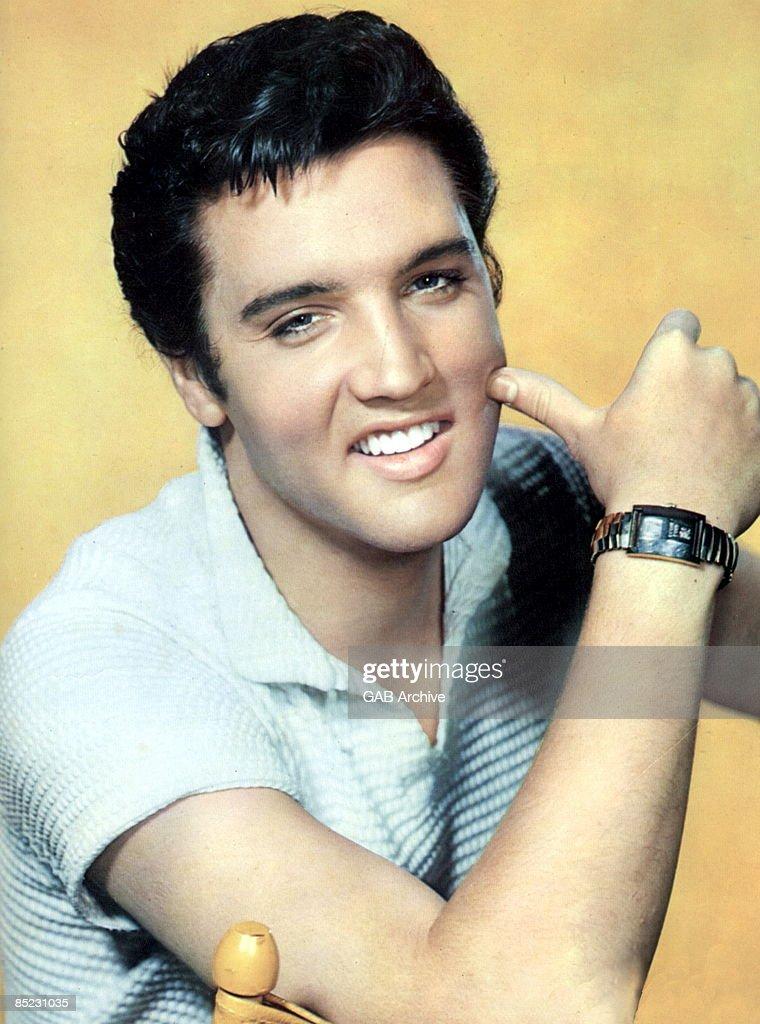 STUDIO Photo of Elvis PRESLEY, posed, studio, c.late 1950s