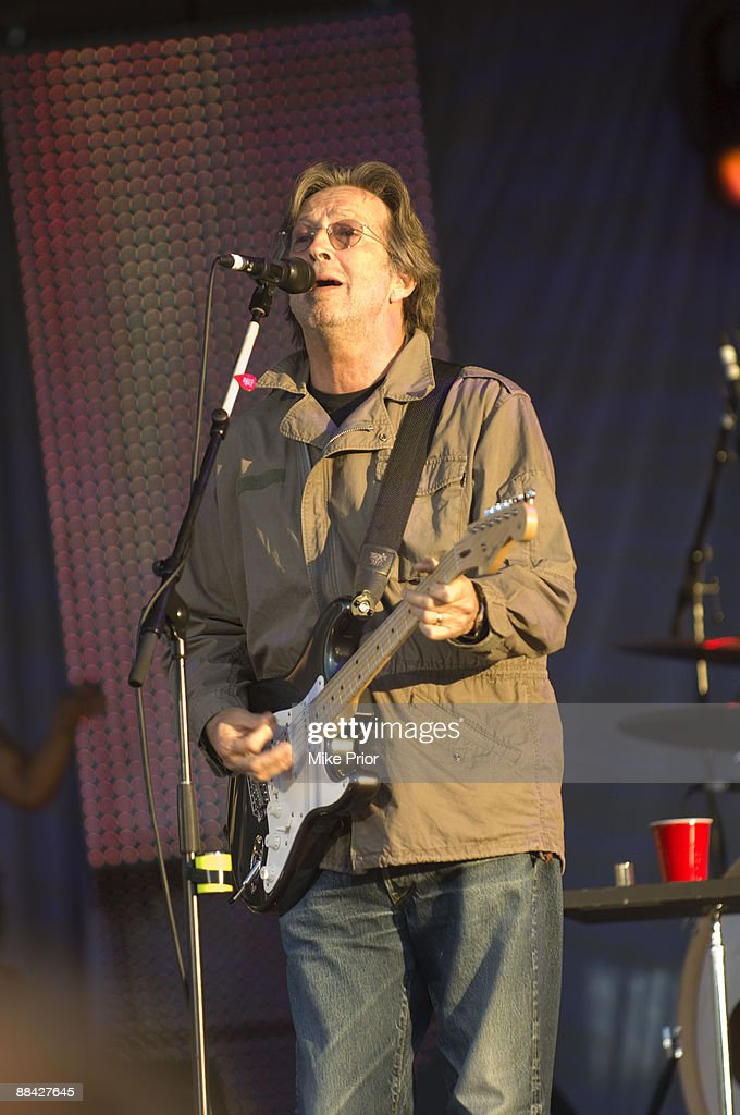 HOUSE Photo of Eric CLAPTON, Eric Clapton performing on stage, Fender Stratocaster