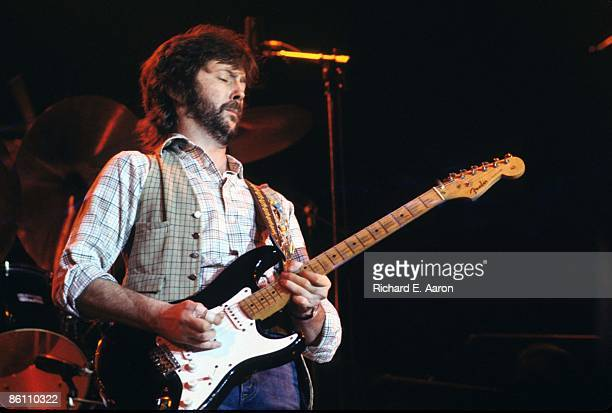 Photo of Eric CLAPTON performing live onstage playing Fender Stratocaster guitar 'Blackie'