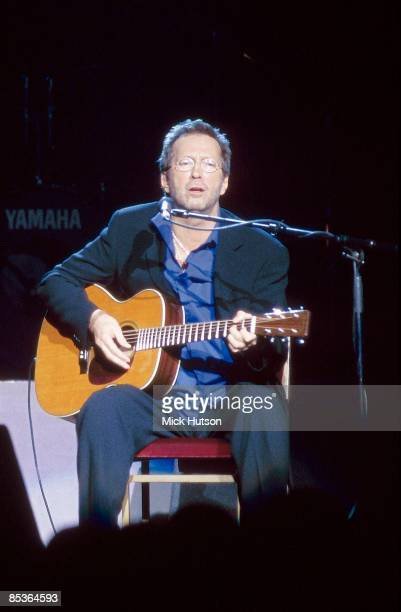 HALL Photo of Eric CLAPTON performing live onstage playing Martin acoustic guitar