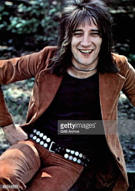 Photo of FACES and Rod STEWART posed Faces era wearing studded belt