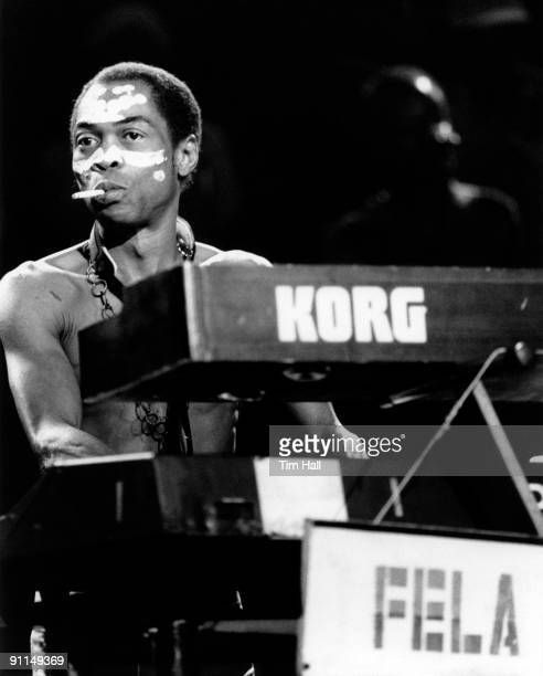 ACADEMY Photo of Fela KUTI Fela Kuti performing on stage smoking cigarette