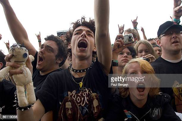 Photo of FESTIVALS and CROWDS and HEAVY METAL FANS rock fans in crowds two boys in the audience watching Korn numetal fans holding soft toywearing...
