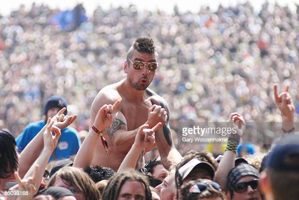 PARK Photo of FESTIVALS and HEAVY METAL FANS and CROWDS and DOWNLOAD FESTIVAL tattooed metal/rock fan raised above the crowd at Download Festival