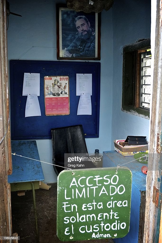 A photo of Fidel Castro hangs above the manager's office at a local fishing dock November 16, 2012 in Havana, Cuba. Despite Cuba's fisheries being at critically low levels according to the United Nations, fishermen are still catching enough to make a living.