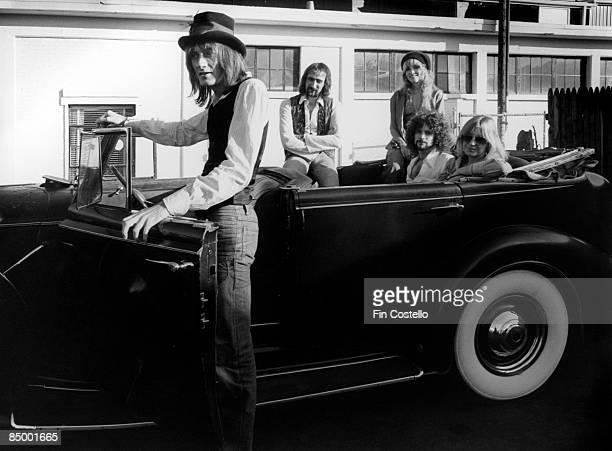 Mick Fleetwood John McVie Stevie Nicks Lindsey Buckingham Chrsitine McVie posed group shot in car