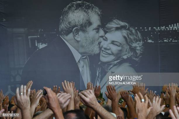 TOPSHOT A photo of former Brazilian president Luiz Inacio Lula da Silva and his late wife Marisa Leticia on display during her funeral at the...