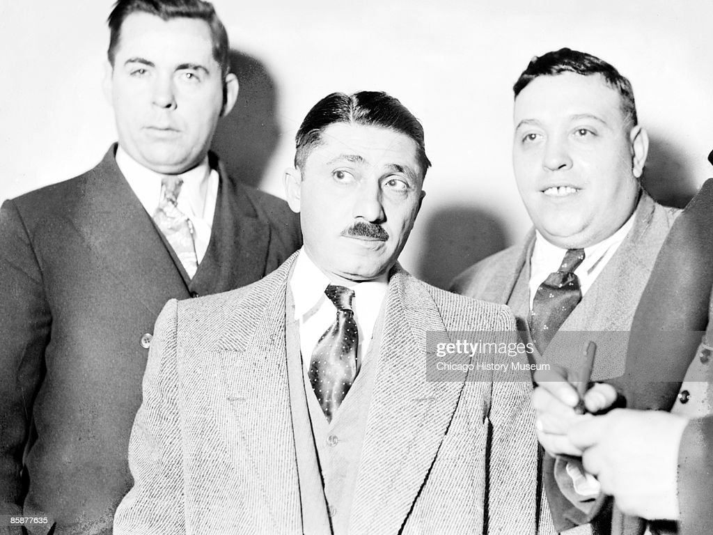 Photo of Frank Nitti (center) who was Al Capone's second in command and oversaw the gang's bootlegging activities, Chicago, ca.1920s. Nitti was nicknamed 'The Enforcer' and took over Capone's organization. From the Chicago Daily News collection.